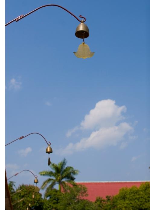 Golden bells and blue sky, Wat Chedi Luang
