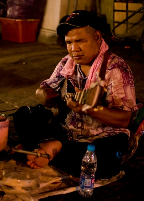 A blind performer, also using his foot to play