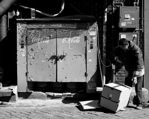 Coca-Cola, a man and a box